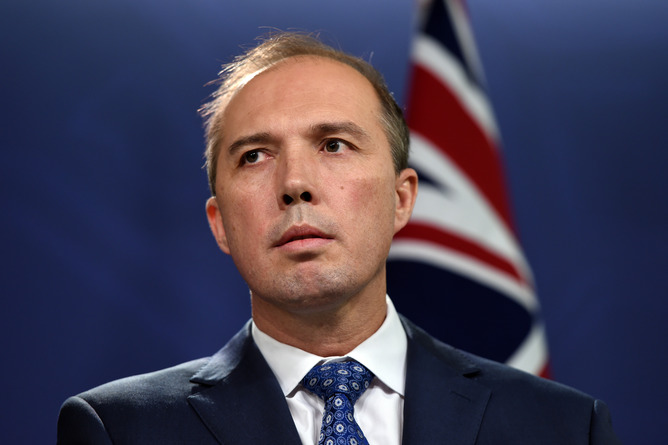 Federal Health Minister, Peter Dutton, answers a question at a press conference in Sydney on Wednesday, Nov. 5, 2014. The Commonwealth Government will increase Australia's $18 million contribution to the response to Ebola in West Africa and strengthen preparations to detect and respond to a possible Ebola case in Australia. (AAP Image/Paul Miller) NO ARCHIVING